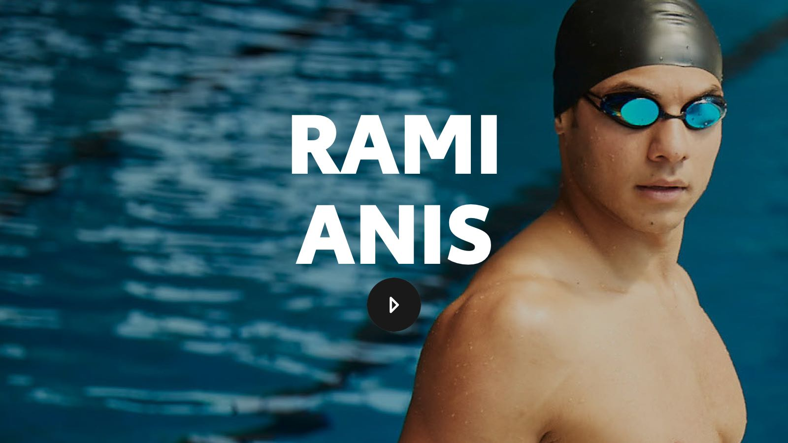 Rami stands in front of a competition pool, dripping from a race and wearing mirrored goggles.