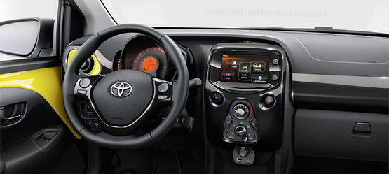 Toyota AYGO, interior dashboard view, yellow styling