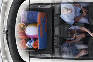 Toyota Verso exterior, aerial shot of family sitting in vehicle with beach items